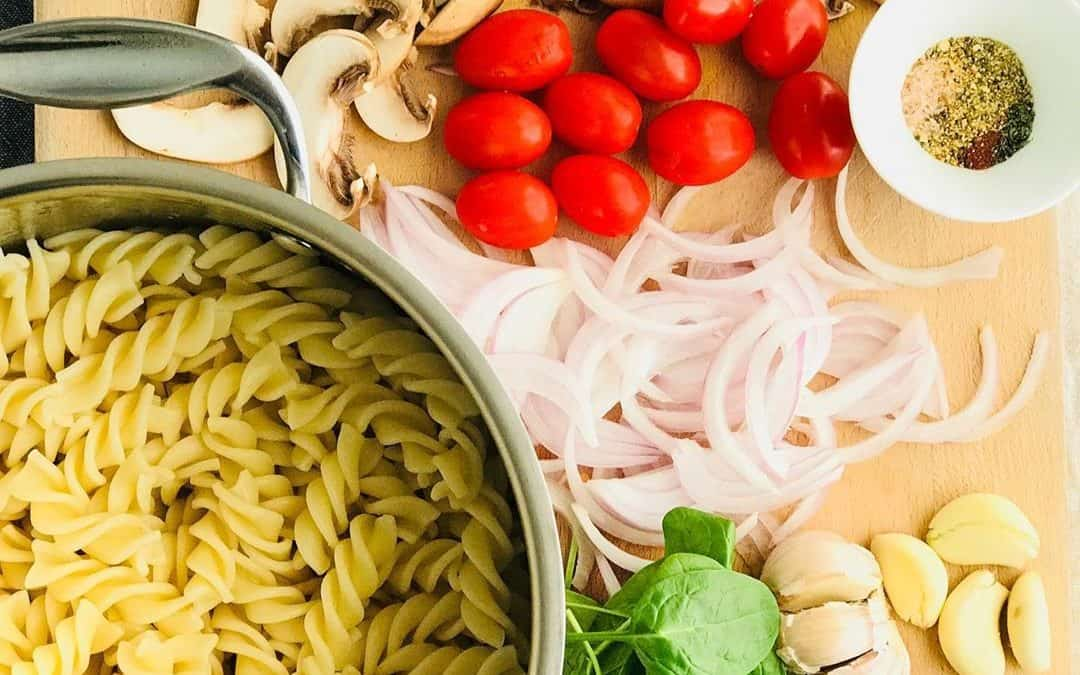 Mushroom & gluten-free pasta with spinach and cherry tomatoes